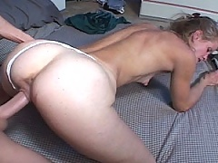 Mature blonde whore gets her face covered in man goo